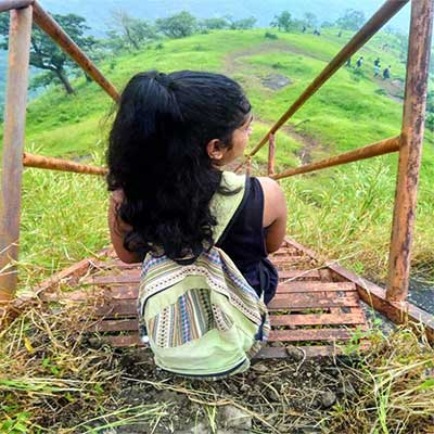 girl-sitting-with-her-bag